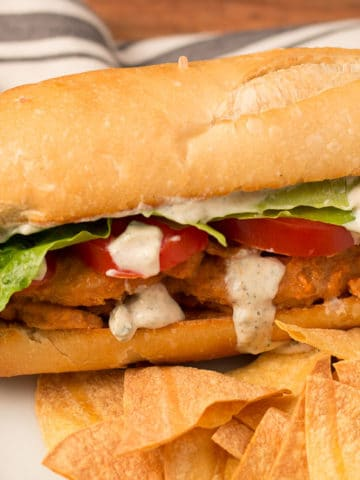 Buffalo Soy Curl Sub sandwich with baked tortilla chips and salsa