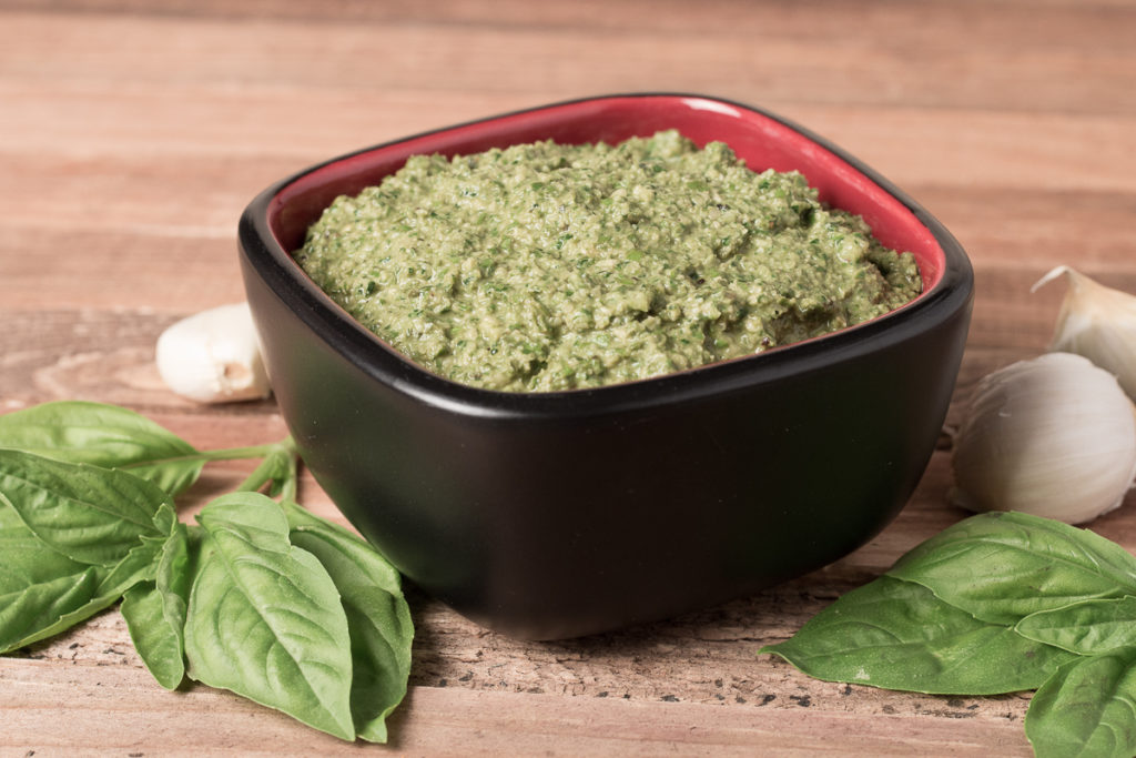 Bowl of Easy Vegan Pesto with basil and garlic sounding bowl