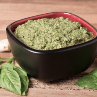 Bowl of Easy Vegan Pesto with basil and garlic sounding bowl