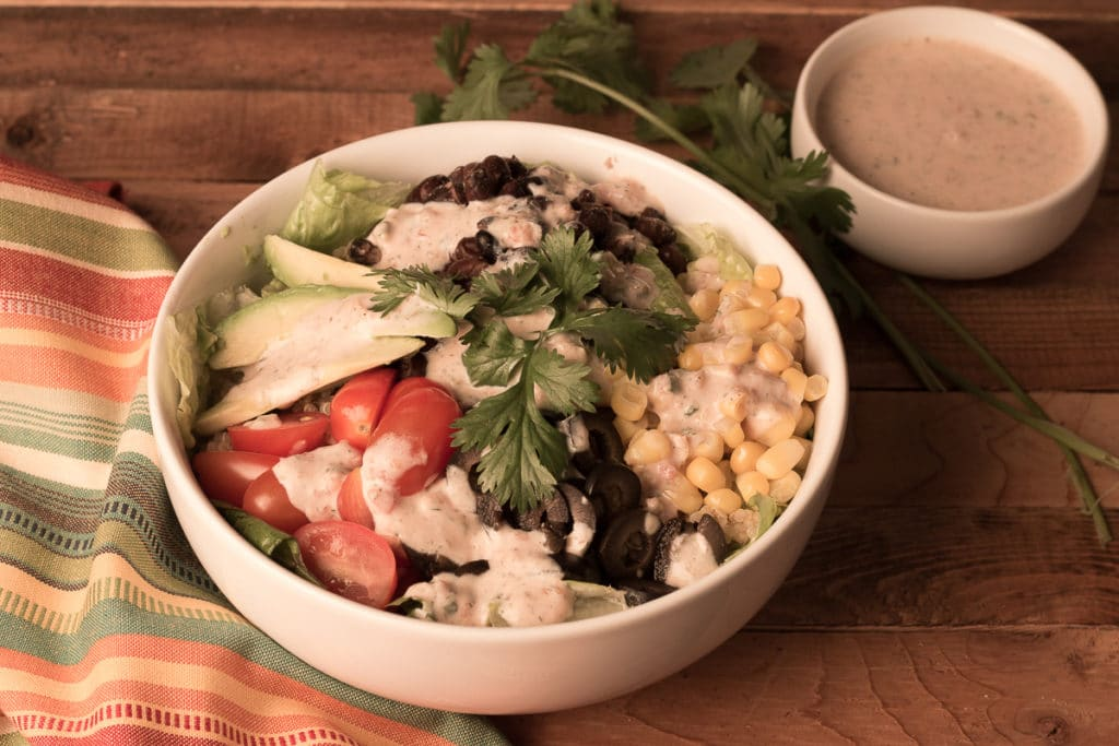 Mexican Quinoa Bowl and small bowl of salsa ranch dressing