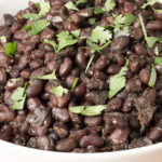 Closeup of bowl of Savory Black Beans cooked in the Instant Pot