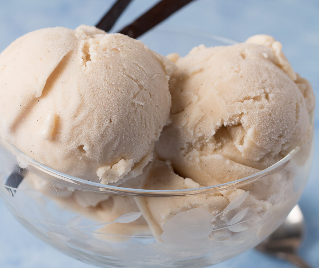 Closeup view of bowl of Vegan Vanilla Ice Cream with vanilla beans