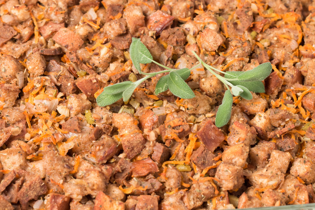 Vegan stuffing topped with sprigs of sage