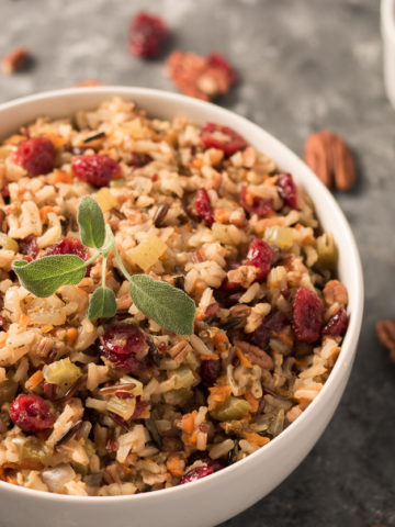 This Holiday Wild Rice Pilaf is a perfect side dish for your holiday feast. The wild rice blend, studded with chopped pecans and dried cranberries, is an oil free, easy, one pot dish. It will be a hit at your next dinner party!