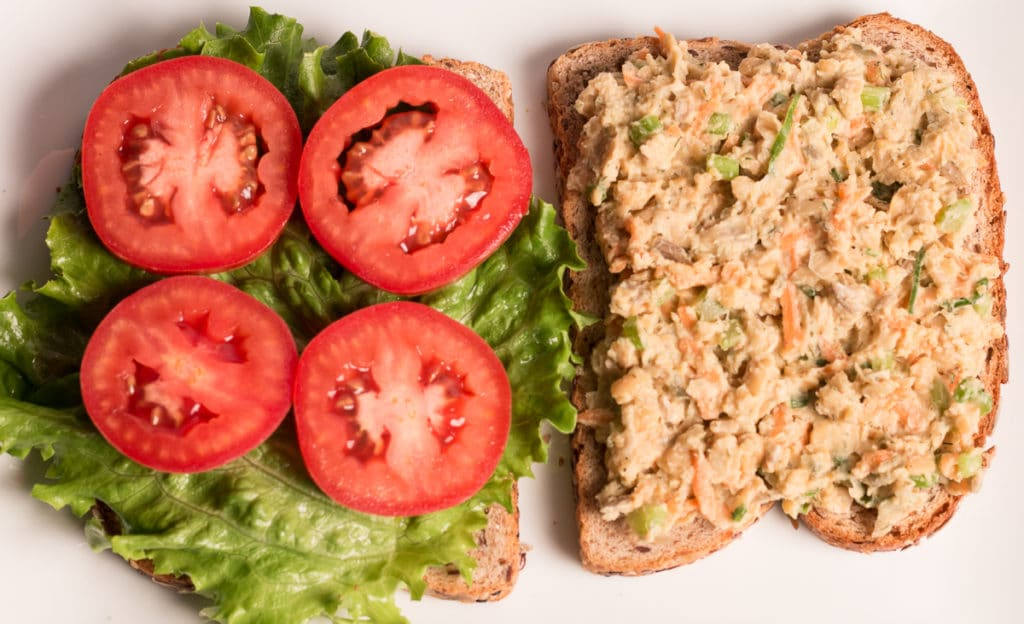 Open face chickpea salad sandwich with lettuce and tomato