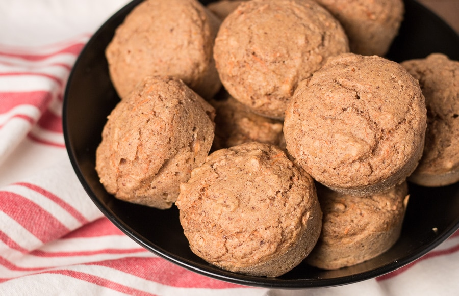 Bowl of carrot muffins on a red and white striped napkin