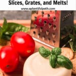 Image of vegan cheese with crackers, tomatoes, basil and cheese grater in background, with Pinterest title above image