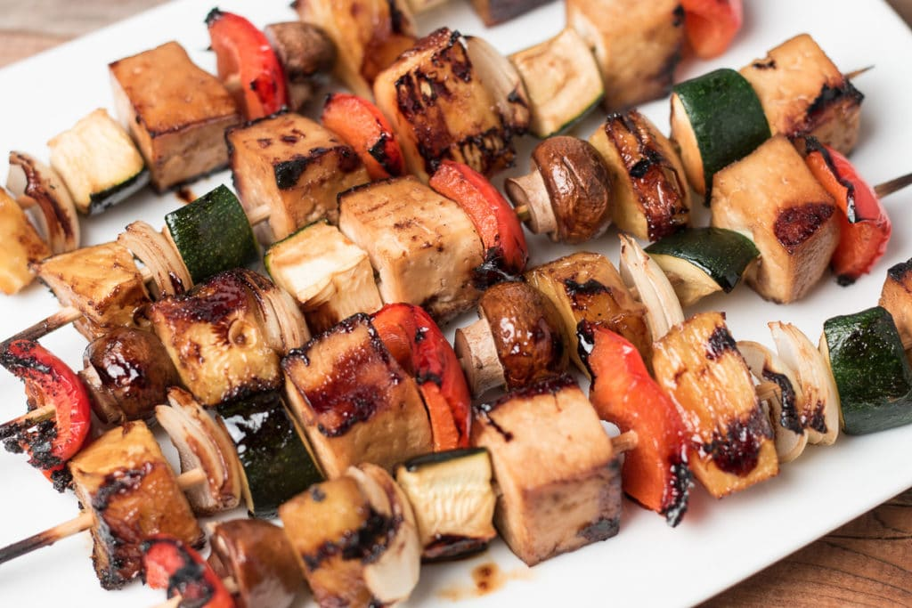 Tofu veggie kabobs on a white platter