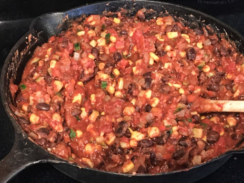 Cast iron skillet with filling for vegan tamale pie