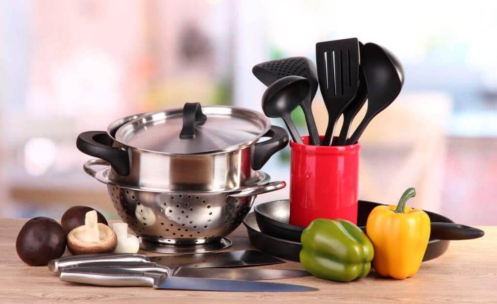 Kitchen tools and vegetables on table