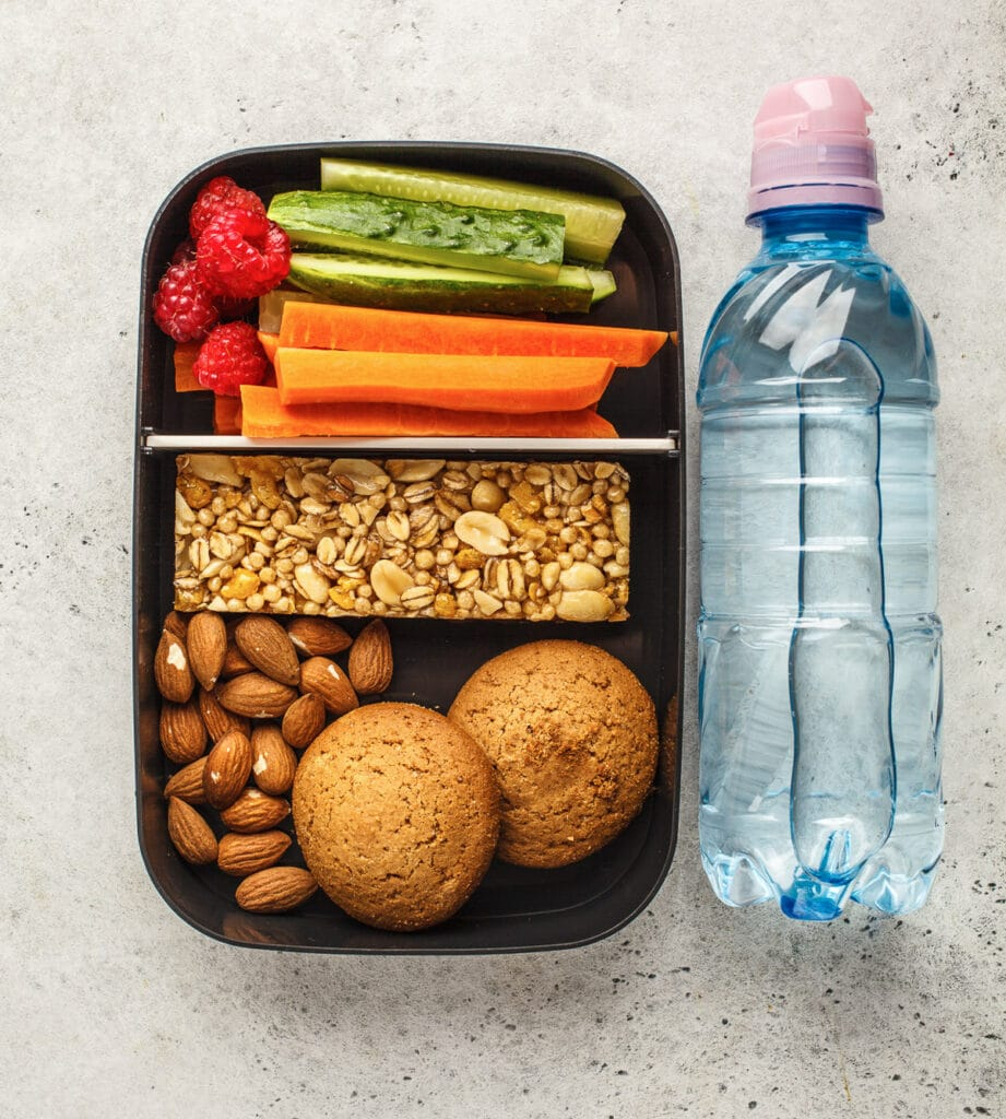 Snacks and water bottle for eating plant baed on the go