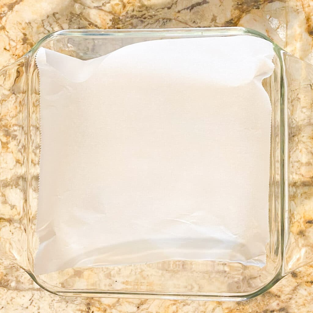 Glass baking pan lined with parchment paper