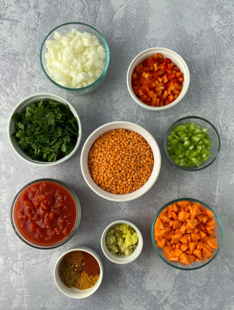 Bowls of ingredients for red lentil dal