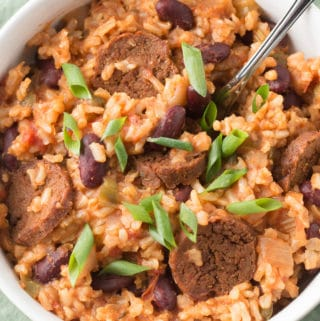 Closeup overhead photo of vegan jambalaya in a white bowl