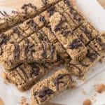 Granola bars on parchment covered cutting board