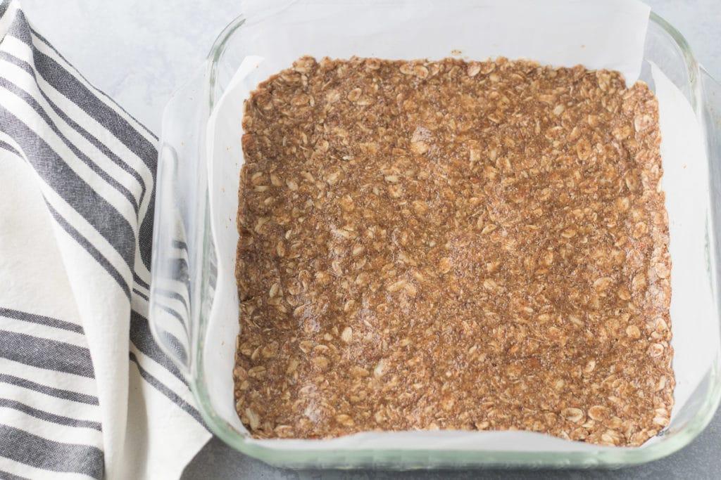 Granola bar mixture pressed into baking pan
