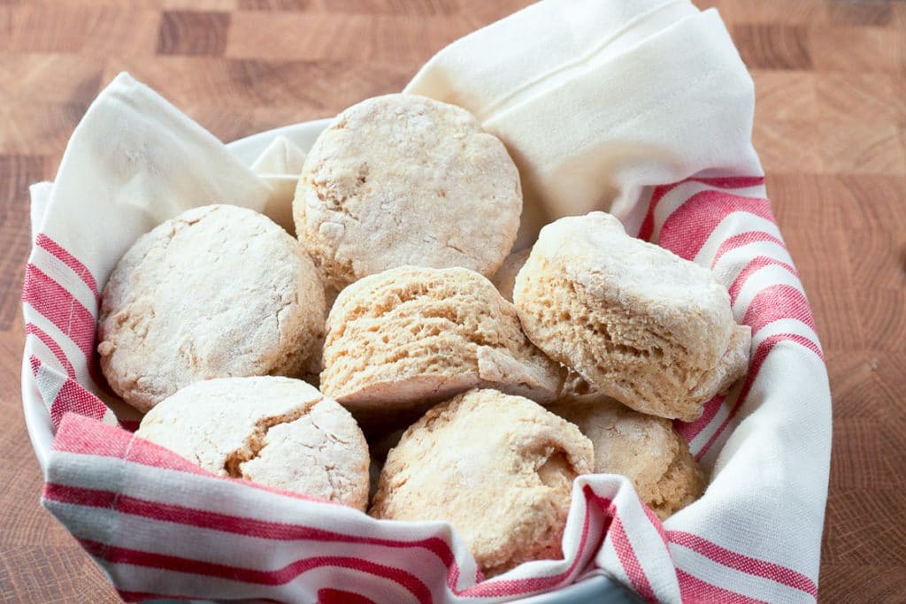Biscuits in bowl lined with red and white striped napkin