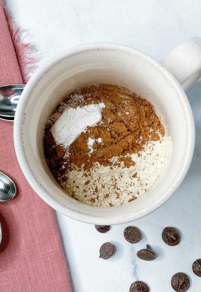 Dry ingredients for mug cake in a mug