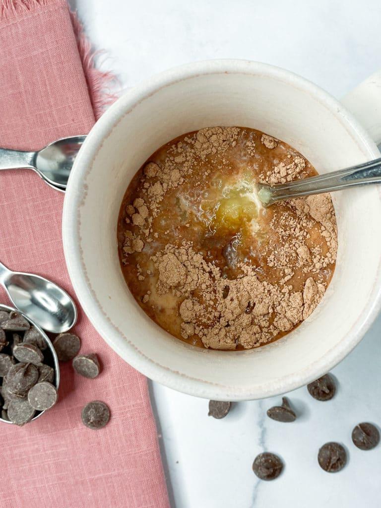 Wet ingredients added to mug for mug cake