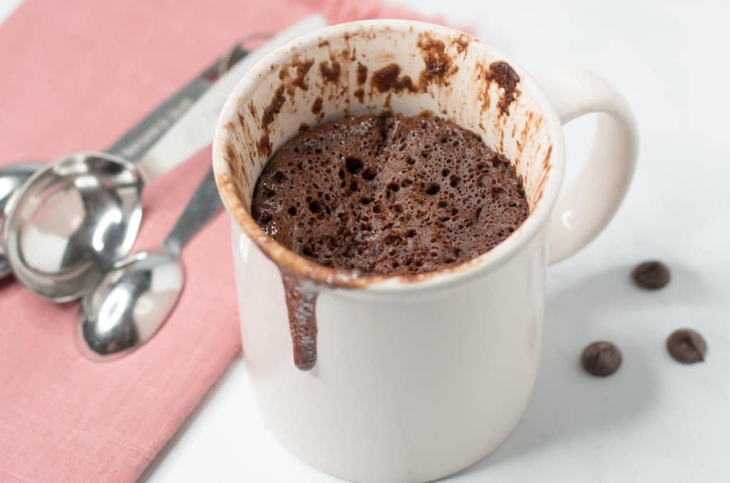 Pink cup with chocolate mug cake