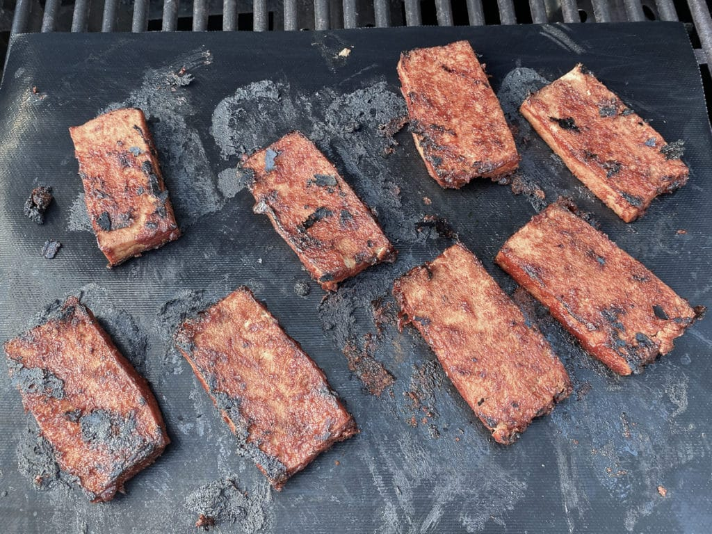 Grilled BBQ Tofu on a grilling mat in the BBQ