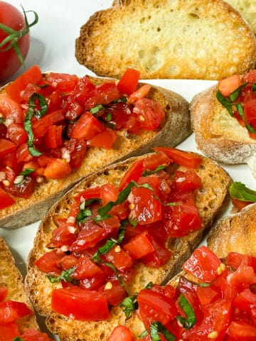 Closeup of tomato basil topping on bruschetta
